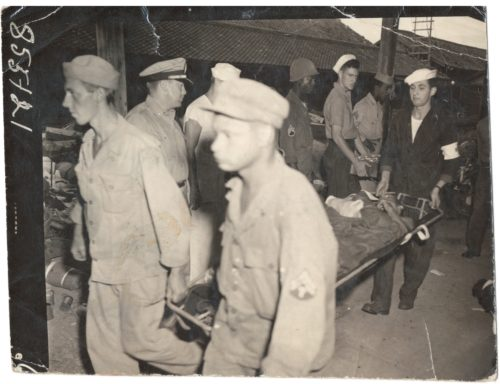 Dr. Thomas A. Harris reviewing incoming POWs in Nagasaki.